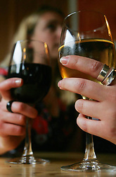 PICTURE POSED BY MODELS. File photo dated 25/04/07 of two women drinking wine as young women who like to party before motherhood risk increasing their chances of breast cancer, research suggests.