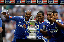 15.05.2010, Wembley Stadium, London, ENG, FA Cup Finale, Chelsea FC vs Portsmouth FC, im Bild Florent Malouda of Chelsea      with Chelsea's Nicolas Anelka and Didier Drogba of Chelsea   lifts FA Cup. EXPA Pictures © 2010, PhotoCredit: EXPA/ IPS/ Marcello Pozzetti / SPORTIDA PHOTO AGENCY