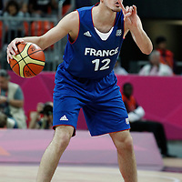 29 July 2012: Nando De Colo of France calls a play during the 98-71 Team USA victory over Team France, during the men's basketball preliminary, at the Basketball Arena, in London, Great Britain.