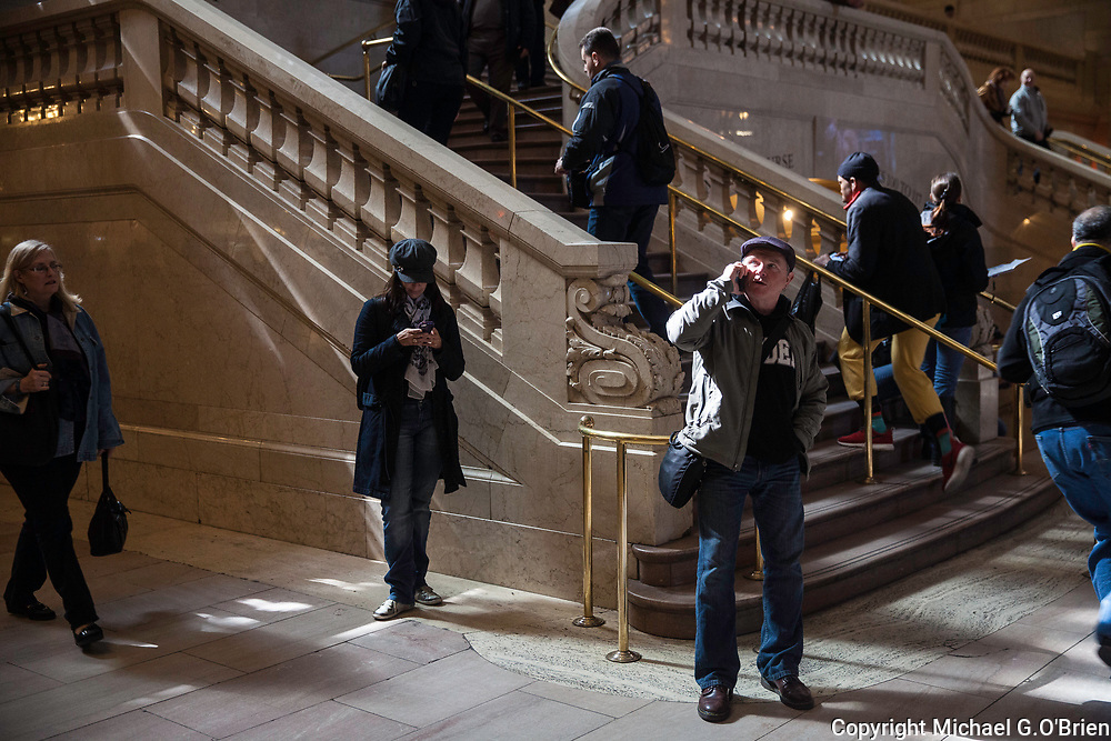 Calling home from the Grand Central Terminal, New York City