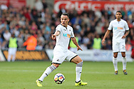 Roque Mesa of Swansea city points the way. Premier league match, Swansea city v Watford at the Liberty Stadium in Swansea, South Wales on Saturday 23rd September 2017.<br /> pic by  Andrew Orchard, Andrew Orchard sports photography.
