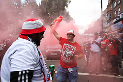 14 September 2017 -  UEFA Europa League (Group H) - Arsenal v FC Koln - FC Koln fans dance in the street on Highbury Corner waving red flares - Photo: Mark Leech/Offside