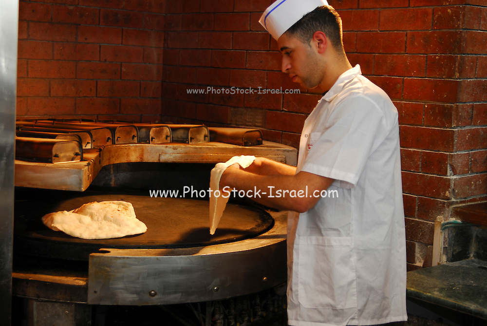 Male baker at work making focaccia