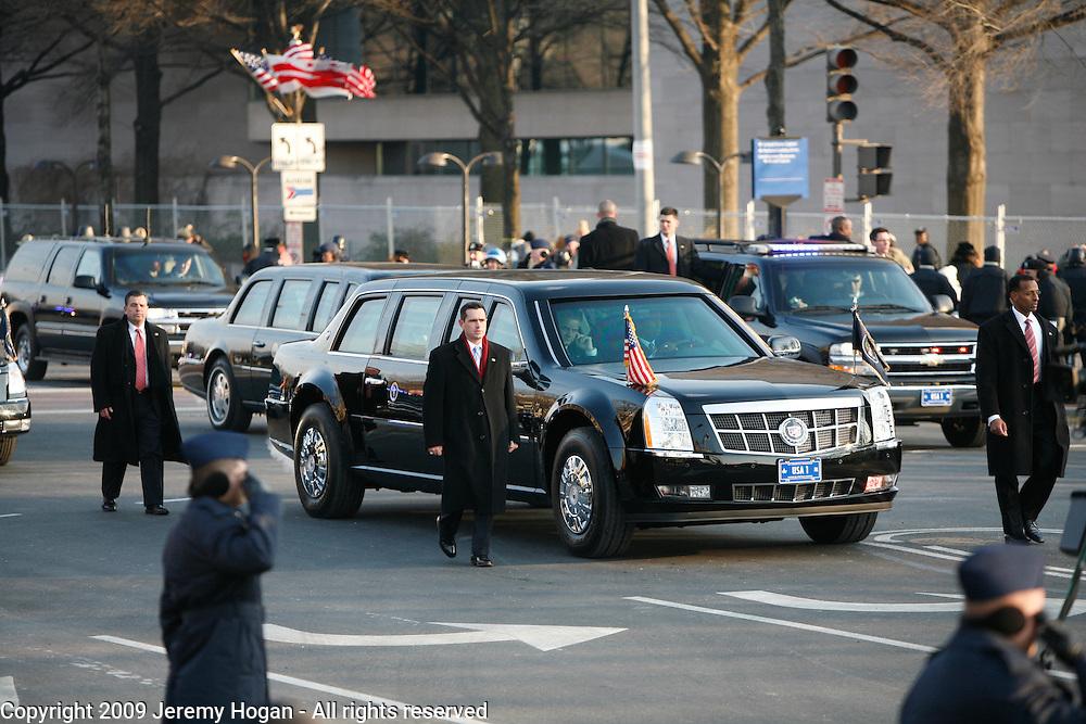 Barack Obama's motorcade moves along Pennsylvania Avenue.