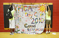 Middletown, New York - Counselors from the Middletown YMCA summer camp hang a banner in the gymnasium on August 20, 2010.