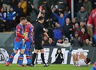 Crystal Palace's Joel Ward is shown a red card for a challenge on Sheffield United's Enda Stevens which is then changed to a yellow card after a VAR review during the Premier League match at Selhurst Park, London. Picture date: 1st February 2020. Picture credit should read: Paul Terry/Sportimage