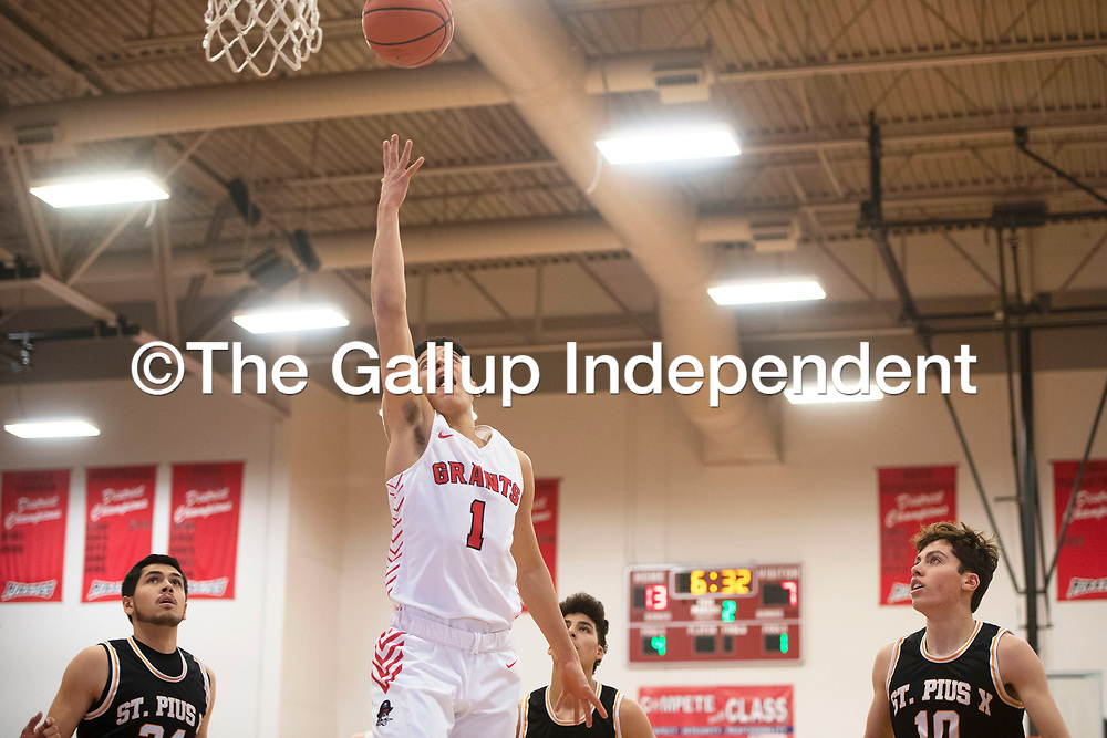Grants Pirate Adam Garcia (1) drives to the basket for a layup against St. Pius X Sartans Saturday at Grants High School in Grants. Grants took the win 60-52.