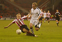 Photo: Aidan Ellis.<br /> Sheffield United v Swansea City. The FA Cup. 06/01/2007.<br /> Swansea's Thomas Butler is brought down by Sheffield's Derek Geary for the penalty