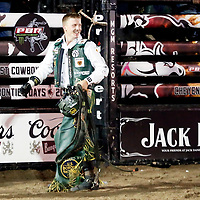 CHEYENNE, WY - JUL 22: Rider Cooper Davis celebrates after riding bull Taco Cat during first round of the Professional Bull Riders Last Cowboy Standing on July 22, 2019, at the Cheyenne Frontier Days, Cheyenne, WY. (Photo by Chris Elise)