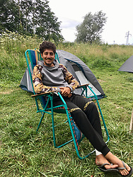 30July2021. Calais, France.<br /> Zana Mohamed (19yrs) a young Kurdish migrant refugee sits outside his tent inside the migrant refugee camp in Dunkerque. British founded charity Care4Calais along with other aid organisations offer food, assistance, phone charging, haircuts, clothing, tents and more to migrant refugees. A new 'Jungle' appears to be springing up from the trees and woods on the outskirts of Dunkerque where conditions are not as hostile or inhospitable as they are currently in Calais 30km to the south.<br /> Photo©; Charlie Varley/varleypix.com