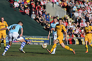 Scot Bennett of Newport county makes a break. Skybet football league two match, Newport county v Exeter city at Rodney Parade in Newport, South Wales on Sunday 16th March 2014.<br /> pic by Andrew Orchard, Andrew Orchard sports photography.