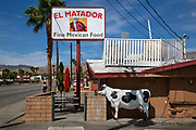 Mexican resturant, El Matador, with plastic cow decoration on the main street of Desert Hot Springs, California