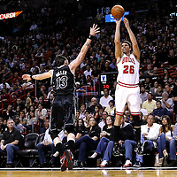 29 January 2012: Chicago Bulls shooting guard Kyle Korver (26) takes a jumpshot over Miami Heat shooting guard Mike Miller (13) during the Miami Heat 97-93 victory over the Chicago Bulls at the AmericanAirlines Arena, Miami, Florida, USA.