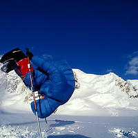 USA, Alaska, (MR) Rick Ford performs somersault while climbing West Buttress Route up Mount McKinley (20,320')
