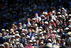 Racegoers in the stands during day two of the Qatar Goodwood Festival at Goodwood Racecourse, Chichester.