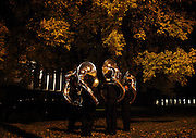 Marian Catholic High School Marching Band sousaphone players break into their group for warm ups before taking the field during 43nd Annual State of Illinois Marching Band Championship at Illinois State University in Normal on Saturday October 24, 2009.
