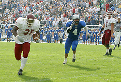 12 October 2002: Terry Ennis hoofs it to the right side after avoiding the defense.  Eastern Illinois University Panthers host and defeat the Colonels of Eastern Kentucky during EIU's Homecoming at Charleston Illinois.