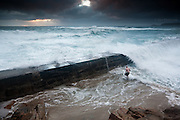 """International Color Awards 2016 - Nominee in """"People"""" category<br /> <br /> Even in the height of the summer, the weather and light in Cornwall can be dramatic and changeable. Huge seas battered the coast and pounded over the small quay wall at Sennen Cove. In some ways understandably, another visitor cheesed off with the lack of summer weather decided to enjoy the bracing Cornish waters anyway, much to the amusement if slight disbelief of the crowds of onlookers :-)"""