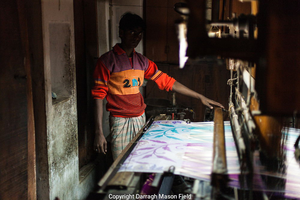 A silk textile factory in the textile district of Varanasi, India.