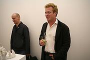 Sebastian Wrong and Tom Astor, Rachel Kneebone private view. Madder Rose. Whitecross St. London EC1 22 June 2006. -DO NOT ARCHIVE-© Copyright Photograph by Dafydd Jones 66 Stockwell Park Rd. London SW9 0DA Tel 020 7733 0108 www.dafjones.com