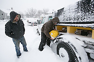 Boston, MA 02/09/2013<br /> Plow drivers try to move a stuck plow truck at the bottom of Greaton Road in West Roxbury on Saturday morning after a blizzard covered Boston in snow.