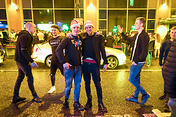 """© Licensed to London News Pictures . 23/12/2017. Manchester, UK. Revellers outside the Printworks in Manchester City Centre overnight during """" Mad Friday """" , named for being one of the busiest nights of the year for the emergency services in the UK . Photo credit: Joel Goodman/LNP"""