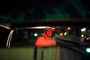 TOKYO, JAPAN, 21-August - Roppongi  - A man wait behing my car at the red light crossing - view from the rear-view mirror -  August 2012 [FR] Un homme avec un casque attends à l'arrière de ma voiture, vue du retroviseur central