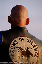 Zeke, Sturgis, SD.  1997<br /> <br /> Limited Edition Print from an edition of 50. Photo ©1997 Michael Lichter.<br /> <br /> The Story:  As a club brother underwent chemotherapy for cancer, Zeke shaved his head to let him know he wasn't alone. It helped. The brother's negative and self-conscious attitude turned around. Three years later, he was in remission and doing great. Zeke has long since grown his hair back.