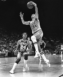 Warriors Rick Barry scores over Dennis Johnson of the Seattle Supersonics..(1977 photo/Ron Riesterer)