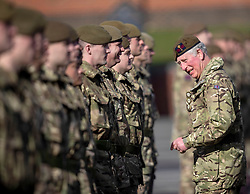 The Prince of Wales, Colonel Welsh Guards, presents campaign medals to soldiers from the 1st Battalion Welsh Guards at Elizabeth Barracks in Woking, following their return from Afghanistan.
