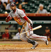 Aug 9, 2012; Houston, TX; USA; Washington Nationals left fielder Roger Bernadina (2) bunts for a single against the Houston Astros during the ninth inning at Minute Maid Park. The Nationals won 5-0. Mandatory Credit: Thomas Campbell-US PRESSWIRE
