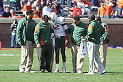 Oct 30, 2010; Charlottesville, VA, USA;  Miami Hurricanes quarterback Jacory Harris (12) walks off the field after a big hit by the Virginia Cavaliers defense in the 1st half of the game at Scott Stadium. Miami Hurricanes quarterback Spencer Whipple (16) took over the quarterback position. Mandatory Credit: Andrew Shurtleff