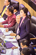 """09 JANUARY 2105 - BANGKOK, THAILAND:  YINGLUCK SHINAWATRA, former Prime Minister of Thailand, presents her defense  during her impeachment trial in the National Legislative Assembly. Thailand's military-appointed National Legislative Assembly began impeachment hearings Friday against former Prime Minister Yingluck Shinawatra. If she is convicted, she could be forced to stay out of politics for five years. During her defense, Yingluck questioned the necessity of her impeachment, saying, """"I was removed from office, the equivalent of being impeached, three times already, I have no position left to be impeached from."""" A decision on her impeachment is expected by the end of January.   PHOTO BY JACK KURTZ"""