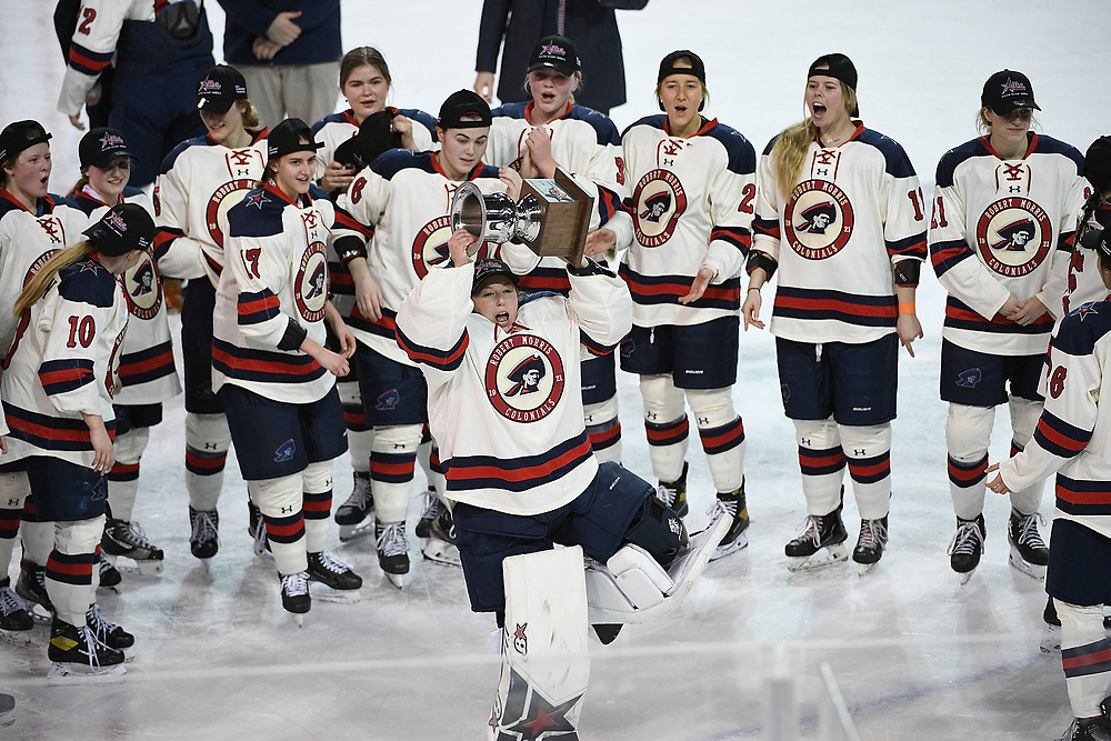ERIE, PA - MARCH 06: Arielle DeSmet #35 of the Robert Morris Colonials hoists the CHA Championship Trophy after the Colonials defeated the Syracuse Orange 1-0 in the championship game at the Erie Insurance Arena on March 6, 2021 in Erie, Pennsylvania. (Photo by Justin Berl/Robert Morris Athletics)