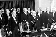 Inaugeration of Cearbhall O'Dalaigh as President  (H77).1974..19.12.1974..12.19.1974..19th December 1974..Following the sudden death of President Erskine Childers, Mr Cearbhall O'Dalaigh was nominated by The Fianna Fail party as its candidate to replace him. The Fine Gael /Labour coalition government did not oppose the nomination and Mr O'Dalaigh was elected un-opposed on a joint party agreement...Pictured standing for the National Anthem is the newly inaugerated president, Cearbhall O'Dalaigh, members of the political parties and judiciary.