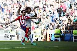 April 8, 2018 - Madrid, Madrid, Spain - Marcelo (Real Madrid) competes for the ball with Juanfran (Club Atletico de Madrid) during the La Liga match between Real Madrid and Atletico de Madrid FC at Estadio Santiago Bernabeu. (Credit Image: © Manu Reino/SOPA Images via ZUMA Wire)