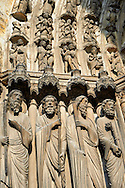 """Medieval Gothic Sculptures of the South portal  of the Cathedral of Chartres, France. The portal shaows the Last Judgement and the small figures represent """"The blessed"""". A UNESCO World Heritage Site. .<br /> <br /> Visit our MEDIEVAL ART PHOTO COLLECTIONS for more   photos  to download or buy as prints https://funkystock.photoshelter.com/gallery-collection/Medieval-Middle-Ages-Art-Artefacts-Antiquities-Pictures-Images-of/C0000YpKXiAHnG2k"""