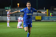 AFC Wimbledon midfielder Callum Reilly (33) celebrating after scoring goal to make it 2-1 during the EFL Sky Bet League 1 match between AFC Wimbledon and Doncaster Rovers at the Cherry Red Records Stadium, Kingston, England on 14 December 2019.