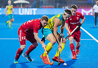 BHUBANESWAR, INDIA - Dylan Wotherspoon (Aus) with Michael Hoare (Eng)   , England v Australia for the bronze medal during the Odisha World Cup Hockey for men  in the Kalinga Stadion.   COPYRIGHT KOEN SUYK