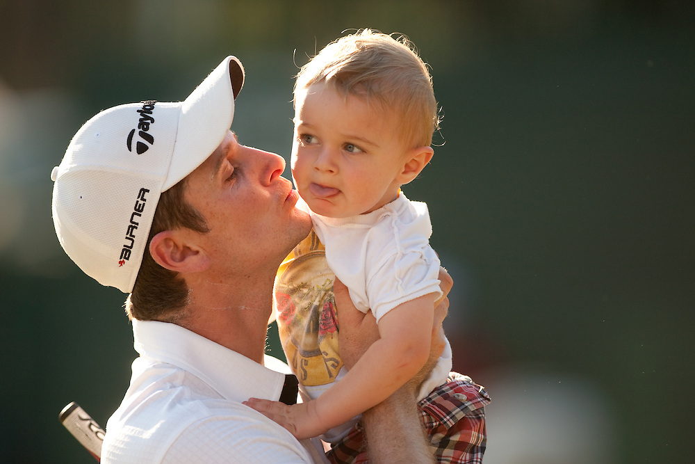 NEWTOWN SQUARE, PA - JULY 4: Justin Rose with his son, Leo, during the fourth round of the AT&T National at Aronimink Golf Club on July 4, 2010 in Newtown Square, Pennsylvania. (Photo by Darren Carroll) *** Local Caption *** Justin Rose