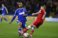David McGoldrick of Ipswich Town challenges Craig Noone of Cardiff city (r). Skybet football league championship match, Cardiff city v Ipswich Town at the Cardiff city stadium in Cardiff, South Wales on Tuesday 21st October 2014<br /> pic by Andrew Orchard, Andrew Orchard sports photography.
