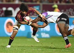 Cape Town-180416  University of Stellenbosch player Michal Haznar  challenged by AK Nela  of UNW in a Varsity Cup final played at Dani Craven stadium in Sellenbosch .photographer:Phando Jikelo/African News Agency/ANA