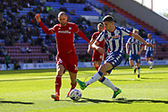 Ryan Colclough of Wigan Athletic (r) looks to shoot but sees his effort blocked by Matthew Connolly of Cardiff City. EFL Skybet Championship match , Wigan Athletic v Cardiff city at the DW Stadium in Wigan, Lancs on Saturday 22nd April 2017.<br /> pic by Chris Stading, Andrew Orchard sports photography.
