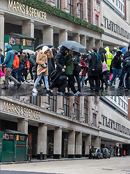 COMBINATION IMAGE © Licensed to London News Pictures. 26/12/2020. London, UK. In this combination image shoppers are seen near Marks and Spencer on Boxing Day in 2019 (TOP) and the same scene today (LOWER). On one of the busiest shopping days of the year a near deserted Oxford Street as all non-essential shops remain closed due to the continuing coronavirus pandemic that has swept through the World. Last week Health Secretary Matt Hancock announced that yet another new Covid-19 mutation has been discovered in the UK as Downing Street orders many more areas of England to go into Tier 4 lockdown from Boxing Day with tougher new Covid-19 restrictions for many as the mutated strains continue to spread throughout the South East. Photo credit: Alex Lentati/LNP