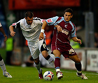 Photo: Jed Wee.<br /> Scunthorpe United v Swansea City. Coca Cola League 1. 08/08/2006.<br /> <br /> Swansea's Kevin McLeod (L) tries to take on Scunthorpe's Billy Sharp.