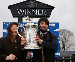Trainer Christian Williams (right) is presented with the winners trophy after seeing Potters Corner ridden by James Bowen win the Marstons 61 Deep Midlands Grand National race at Uttoxeter Racecourse.