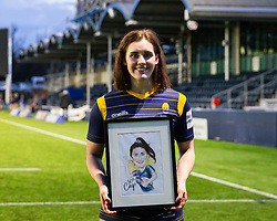 Meg Varley is presented with a frame caricature after making her 50th appearance for Worcester Warriors Women  - Mandatory by-line: Nick Browning/JMP - 20/12/2020 - RUGBY - Sixways Stadium - Worcester, England - Worcester Warriors Women v Harlequins Women - Allianz Premier 15s