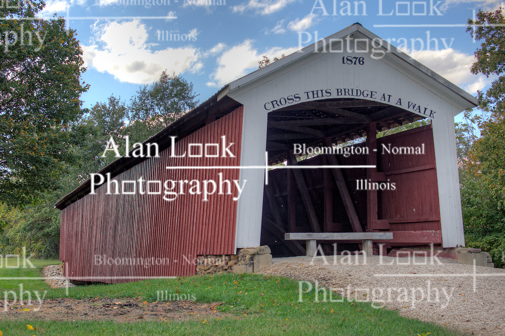 06 October 2013:   06 October 2013:   The Hillsdale Covered Bridge, also known and Possum Bottom or Jackson's Ford Covered Bridge, originally crossed the Little Raccoon Creek Vermillion County. This single span Burr Arch Truss structure has a length of 104 feet, or 124 feet including the 10-foot overhang at each end, with a portal clearance 13 feet 6 inches wide by 12 feet high. Built in 1876 by Joseph J. Daniels, The Hillsdale Covered Bridge was move to its present location in 1973, becoming the centerpiece of the Ernie Pyle Rest Park on State Road 36 in Section 35, Township 16 North, and Range 10 West, east of Dana, Vermillion County.<br /> <br /> Parke County Indiana is the site of the Indiana Covered Bridge Festival every October<br /> <br /> This image was produced in part utilizing High Dynamic Range (HDR) processes.  It should not be used editorially without being listed as an illustration or with a disclaimer.  It may or may not be an accurate representation of the scene as originally photographed and the finished image is the creation of the photographer.