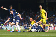Burton Albion midfielder Marcus Harness (16) and Southend United defender Taylor Moore (23) scramble for the ball during the EFL Sky Bet League 1 match between Southend United and Burton Albion at Roots Hall, Southend, England on 22 April 2019.