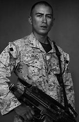 Lcpl. Jesus Ortega, 20, El Paso, Texas, 1st Platoon, Kilo Co., 3rd Battalion 1st Marines, 1st Marine Division, United States Marine Corps, at the company's firm base in Haditha, Iraq on Thursday Oct. 27, 2005.
